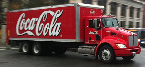 Coca Cola truck busy street