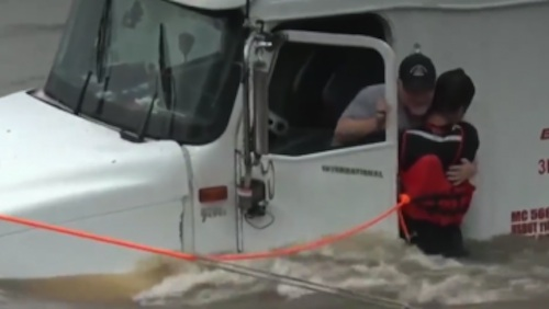 Truck driver rescued from Texas flood
