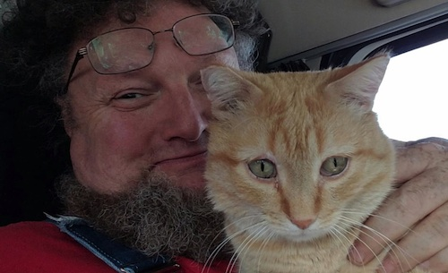 Truck driver Paul Robertson and Percy the cat