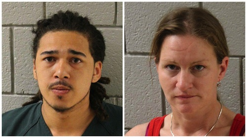 couple arrested for shooting at truck driver