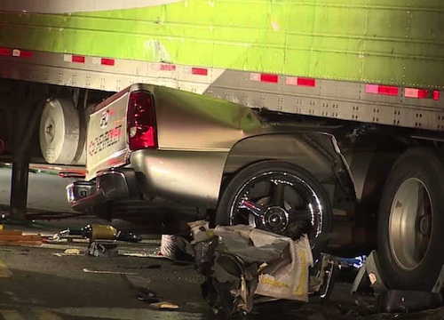 Pick-up dragged by semi-truck