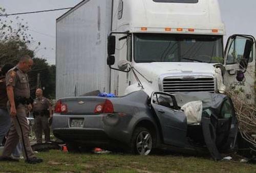 truck runs over truck driver