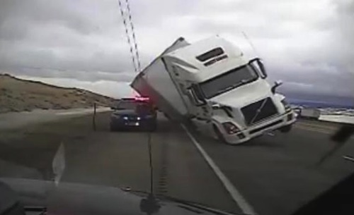 Semi crushes patrol car