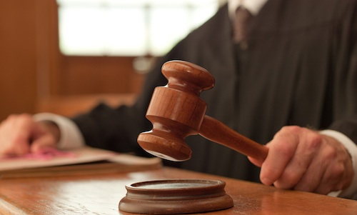 Court charges defendants in trucking scam