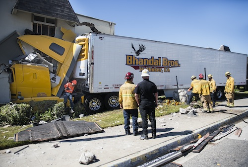 truck driver crashes into building